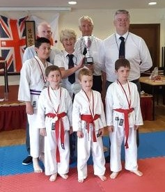 A photo of karate trophy winners